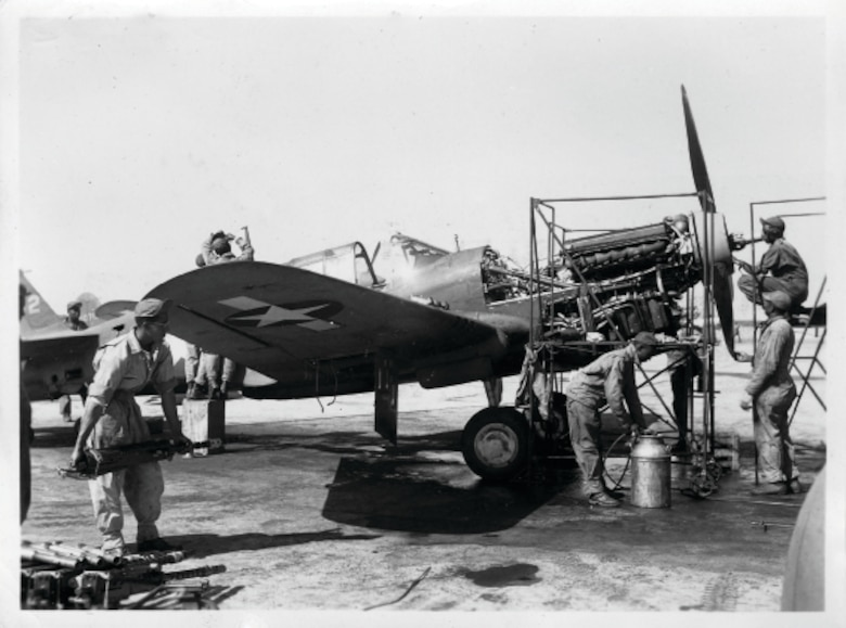 "Aircraft mechanics from a ""Tuskegee Airmen"" unit perform engine maintenance on a P-40 Warhawk at what is now called Selfridge Air National Guard Base in this photo taken likely sometime between March and September 1943, during World War II. During the war, Selfridge served as one of several key training sites for the all-African American units. (Air Force file photo)"