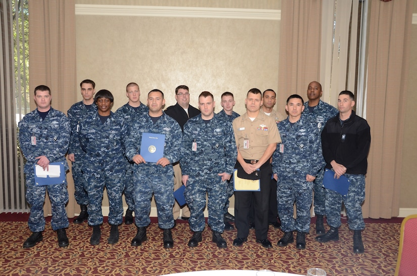 Joint Base Charleston Navy Sailors gather during the inaugural JB Charleston Individual Augmentee Appreciation Luncheon, Feb. 15, 2013, at the Redbank Club at JB Charleston – Weapons Station, S.C. Individual Augmentees perform duties outside of standard Navy platforms alongside Soldiers, Marines and Airmen world-wide. (U.S. Navy photo/Petty Officer 1st Class Chad Hallford)