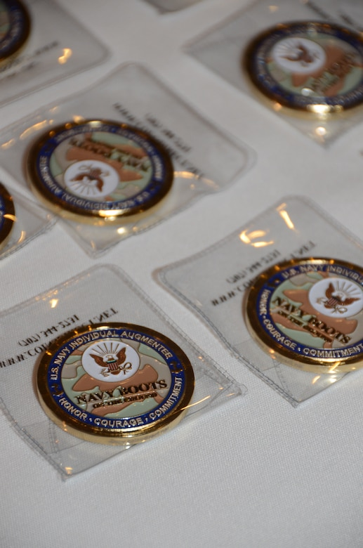 """""""Boots on Ground"""" command coins are laid out for Navy CAPT. Tom Bailey, Joint Base Charleston Deputy commander, to present to returning Navy Individual Augmentees during the inaugural IA Appreciation Luncheon  Feb. 15, 2013,  at the Redbank Club at JB Charleston – Weapons Station, S.C.  . Individual Augmentees perform duties outside of standard Navy platforms alongside Soldiers, Marines and Airmen world-wide. (U.S. Navy photo/Petty Officer 1st Class Chad Hallford)"""