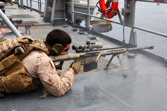 Corporal Diego Oropeza, scout sniper, Scout Sniper Platoon, Weapons Company, Battalion Landing Team 3/5, 15th Marine Expeditionary Unit, fires an M107 Sniper Rifle at a floating  target while conducting Maritime Interoperability Training aboard the USS Rushmore, Feb. 25. The 15th MEU is deployed as part of the Peleliu Amphibious Ready Group as a U.S. Central Command theater reserve force, providing support for maritime security operations and theater security cooperation efforts in the U.S. 5th Fleet area of responsibility. (U.S. Marine Corps photo by Cpl. Timothy R. Childers/Released)
