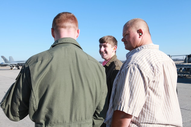 Lt. Col. Sean DeWolfe tells Charlie Bowers about F/A-18s as Bowers watches a VMFA-115 jet takeoff. MAG-31 gave Bowers, a Bluffton High School student, a tour. Bowers wanted to be a fighter pilot until he discovered that he is slowly going blind.