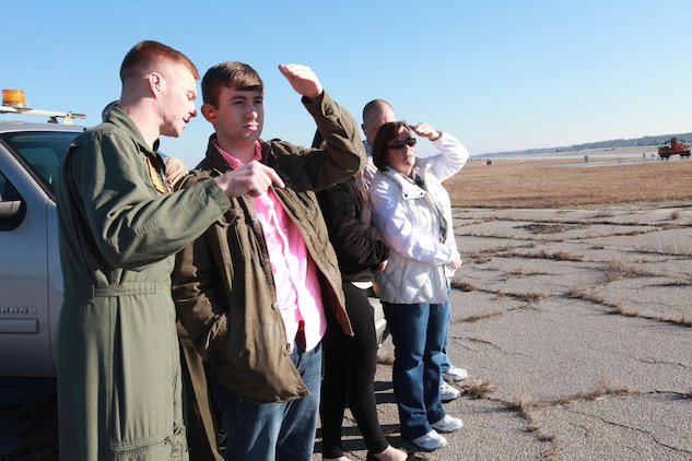 Lt. Col. Sean DeWolfe tells Charlie Bowers about F/A-18s as Bowers watches a VMFA-115 jet takeoff. Bowers, a Bluffton High School student, wanted to be a fighter pilot until he discovered that he is slowly going blind.