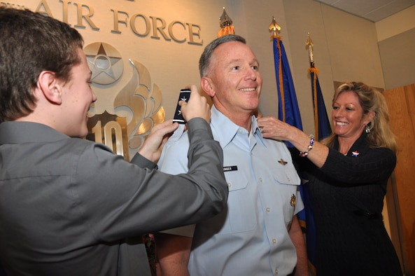 Tenth Air Force Commander Bill Binger pinned on his second star during a small ceremony at the Naval Air Station Fort Worth Joint Reserve Base, Texas, Feb. 2. Changing his shoulder boards were his son, to his left, and his wife, on his right. Maj. Gen Kevin Pottinger, Mobilization Assistant to the Vice Commander, Pacific Air Forces, Joint Base Pearl Harbor-Hickam, Hawaii. was the officiating officer. (U.S. Air Force photo/Master Sgt. Julie Briden-Garcia)