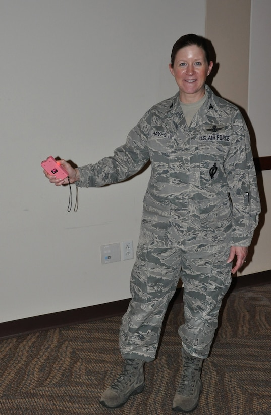 Col. Tracey Hayes, 460th Space Wing vice commander, tests a stun gun during the Ladies' Empowerment Social and Book Club event Feb. 27, 2013, at the Leadership Development Center, Buckley Air Force Base, Colo. Approximately 40 women attended the social, which was part one of a two-part series about self defense.  Attendees were able to view and handle self-defense products such as stun guns, pepper spray and various travel security items. (U.S. Air Force photo by Staff Sgt. Kali L. Gradishar/Released)
