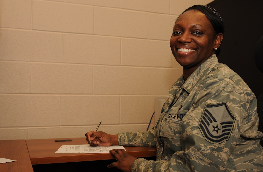 New York Air National Guard Master Sgt. Sonja Williams poses while working in her new office at the Joint Health and Wellness Center, Hancock Field Air National Guard Base, Syracuse, New York on February 3, 2013. Williams recently took over as the 174th Attack Wing's Human Resource Advisor, where she focuses on force management, force development and diversity. (Photo by New York Air National Guard Senior Airman Duane Morgan/Released).