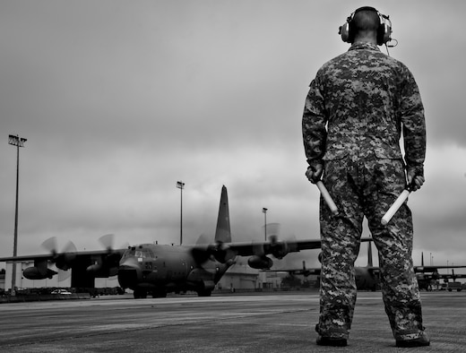 Master Sgt. Robert Hoeft, of the 919th Aircraft Maintenance Squadron, prepares to marshal out an MC-130E Combat Talon I at Duke Field, Fla.  There are only five Talons left at the special operations reserve base.  The 919th has begun remissioning to the Aviation Foreign Internal Defense aircraft, the C-145 Skytruck.  (U.S. Air Force photo/Tech. Sgt. Samuel King Jr.)