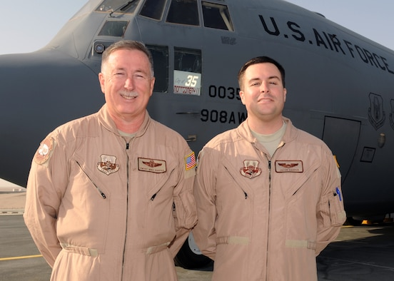 SOUTHWEST ASIA – Chief Master Sgt. Michael E. Harper (left) and his son, Capt. Michael J. Harper, are deployed for the third time together with the 746th Expeditionary Airlift Squadron. This is the chief's final deployment, as he will retire in August after 36 years. Both Airmen are Reservists deployed from the 908th Airlift Wing at Maxwell Air Force Base Ala. (U.S. Air Force photo/Senior Airman Joel Mease)