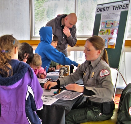 At Orbit Three, NRS Brownlee gives hands-on demonstrations of how magnets at the Great Electrifying Event at Bonneville Lock and Dam, which was held on Feb. 23, 2013.