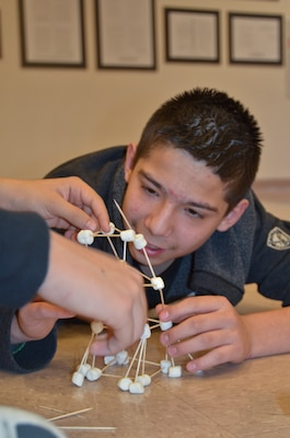 Students from Rogers Elementary School build a tower from toothpicks and mini-marshmallows.