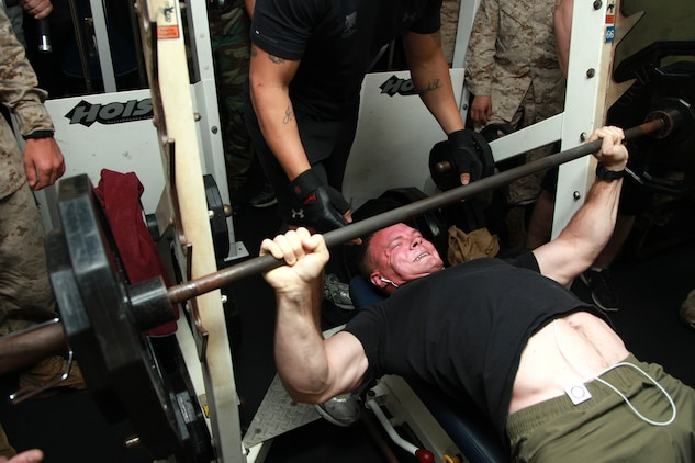 First Lt. Joel M. Steele, platoon commander, 2nd Platoon, Kilo Company, Battalion Landing Team 3/5, 15th Marine Expeditionary Unit, pushes out his final repetition during the Bench Press Competition in the gym of the USS Peleliu, Dec. 29. The challenge was the seventh competition in the Campbell Cup, a bi-monthly challenge that pits teams within the 15th MEU and Peleliu Amphibious Ready Group against each other. The goal was for teams of up five Marines or sailors to do as many bench presses as possible per team member. The 15th MEU is deployed as part of the Peleliu ARG as a U.S. Central Command theater reserve force, providing support for maritime security operations and theater security cooperation efforts in the U.S. 5th Fleet area of responsibility. Steele, 27, is from Graham, Texas.