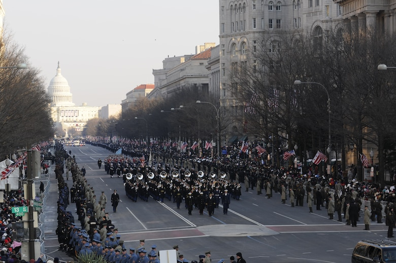 Parade participants march down Pennsylvania Avenue during the 2009 presidential inaugural parade in Washington, D.C., Jan. 20, 2009. More than 5,000 men and women in uniform will be providing military ceremonial support to the 2013 presidential inauguration, a tradition dating back to George Washington's 1789 inauguration. (DoD photo by Mass Communication Specialist 2nd David Coleman, U.S. Navy/Released)