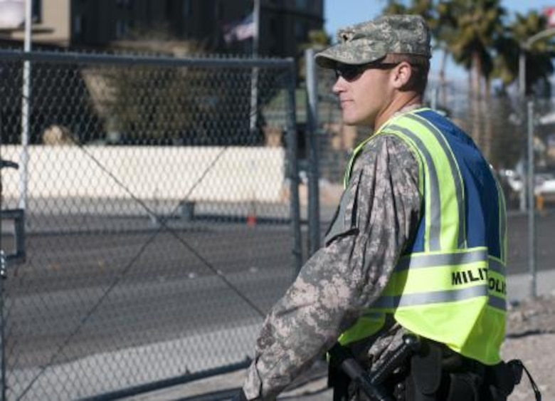 Spc. Rainier Frost of the 137th Military Police Company guards a gate in Las Vegas during Operation Vigilant Sentinel. NV ARNG photo by Spc. James Pierce, 106th Public Affairs Detachment