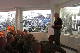 Arthur Barbosa, a retired Marine and docent, gives a class on Marine history to recruits of Company D, 1st Recruit Training Battalion, aboard Marine Corps Recruit Depot San Diego, Dec. 19. The class took place during a tour of the Command Museum aboard MCRD San Diego.