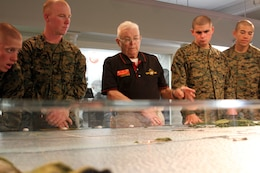 Mike Whaley, a retired Marine and docent, explains a scale model display of the Pacific Theatre of War to recruits of Company D, 1st Recruit Training Battalion,during their tour of the depot's Command Museum aboard Marine Corps Recruit Depot San Diego, Dec. 19.