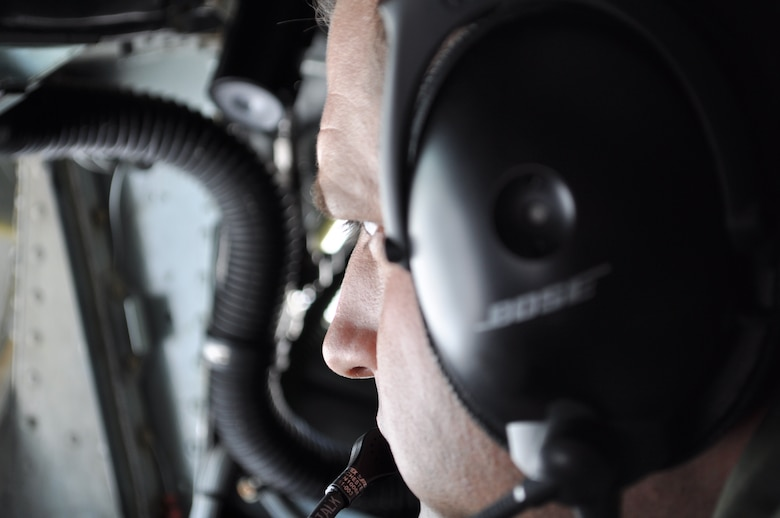 465th Air Refueling Squadron Boom Operator, Jeff Bass, intensely focuses on the E-3 AWACS  moving back and forth less than 50 feet from the tail of a KC-135.  Bass coordinates the aerial refueling for more than one-hour and forty minutes as pilots of both planes rely on his skill to the planes safe while off-loading 50,000 gallons of fuel.