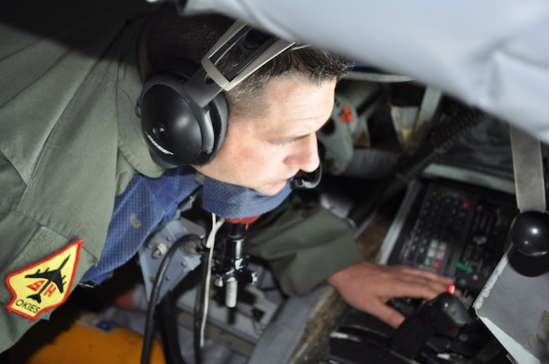 Master Sgt. Jeff Bass, 465th Air Refueling Squadron Boom Operator rests his chin in preparation for a training mission with the 966th Airborne Air Control Squadron out of Tinker Air Force Base.  Bass sends a series of light signals to the pilots of the E-3 Sentry to guide them in for connection with the boom.