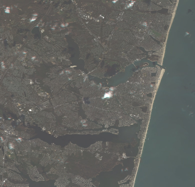 Right center of the image depicts Point Pleasant Beach, NJ. This image is from RapidEye-3. It is a 7-meter multispectral image. Even at 7-meters resolution heavy sand and sediment build up can be seen in the costal roads and streets. (photo courtesy 169th CF, Eagle Vision/Released)