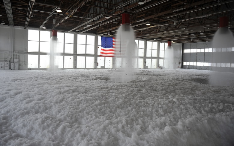Aqueous Film Forming Foam, or AFFF, fills Hangar 211 Dec. 21, 2012, at Mountain Home Air Force Base, Idaho. Personnel from the 366th Civil Engineering Squadron performed the test to ensure aircraft maintainers who work inside this hangar will have a safe place to perform their operations – in the event of a fire the system will protect the Airmen and equipment. (U.S. Air Force photo/Senior Airman Heather Hayward)