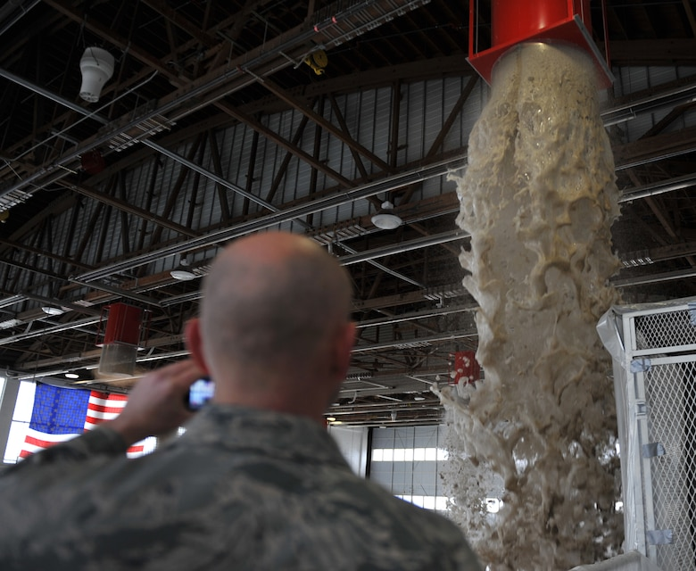 Foam pours out of a dispenser generator inside Hangar 211 Dec. 21, 2012, at Mountain Home Air Force Base, Idaho. Every two years, Airmen are required to test the fire suppression systems in order to protect people and equipment. (U.S. Air Force photo/Senior Airman Heather Hayward)