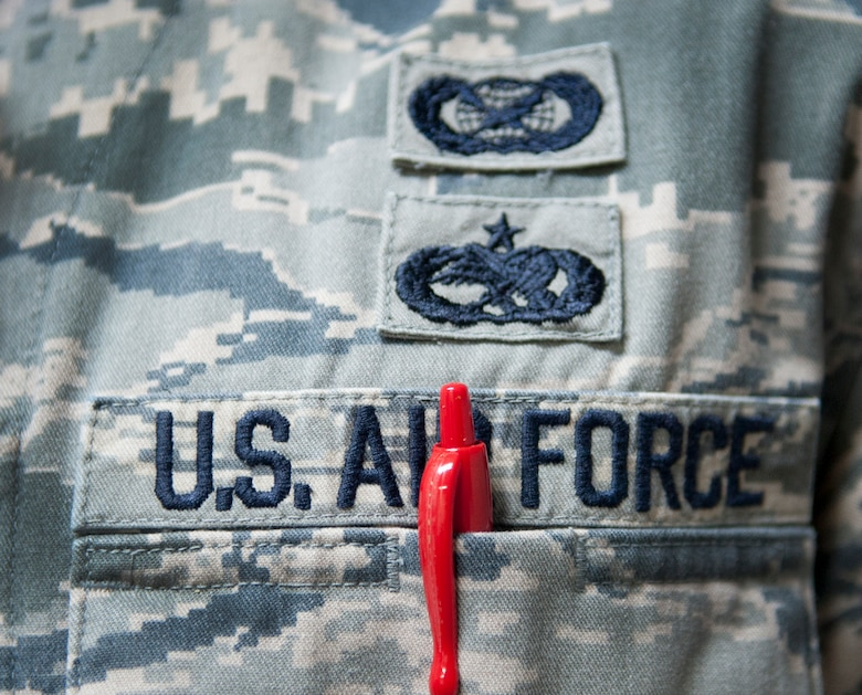 Though red pens are often seen as leaving negative remarks on one's career, they are in fact used as tools to help better Airmen. From fixing aircraft to correcting papers, each stroke makes a mark in pursuing excellence. (U.S. Air Force photo by Senior Airman Daniel Phelps/Released)
