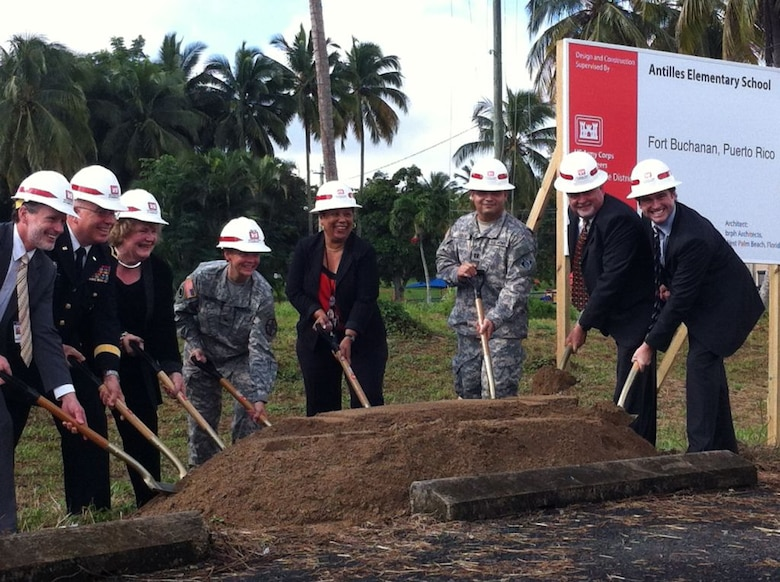 Shovels hit the ground, signifying the beginning of construction for a state-of-the art elementary school at Fort Buchanan, Puerto Rico. The school is one of the first Department of Defense Education Activity (DoDEA) schools that will incorporate 21st century school design elements. Pictured (l to r): Michael Gould, DoDEA school superintendent; Maj. Gen. Antonio J. Vicens, Adjuntant General of the Puerto Rico National Guard; Dr. Elizabeth Middlemiss, DoDEA headquarters; Col. Susan Heard , Fort Buchanan commander; Lydia Blazquez, Antilles Elementary School principal; Capt. J.C. Cordon, deputy district engineer for the Antilles; Yamil Castillo, chief, Antilles Construction Office; and William Gilbane III, Gilbane Company.