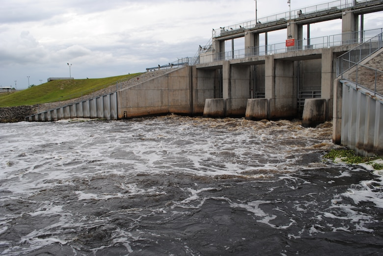 Water flows through the gates of the Moore Haven Lock in October, as Jacksonville District started discharges from Lake Okeechobee to stem the rapid rise in lake levels after Tropical Storm Isaac.  The releases began Sept. 19 and continued until early November.