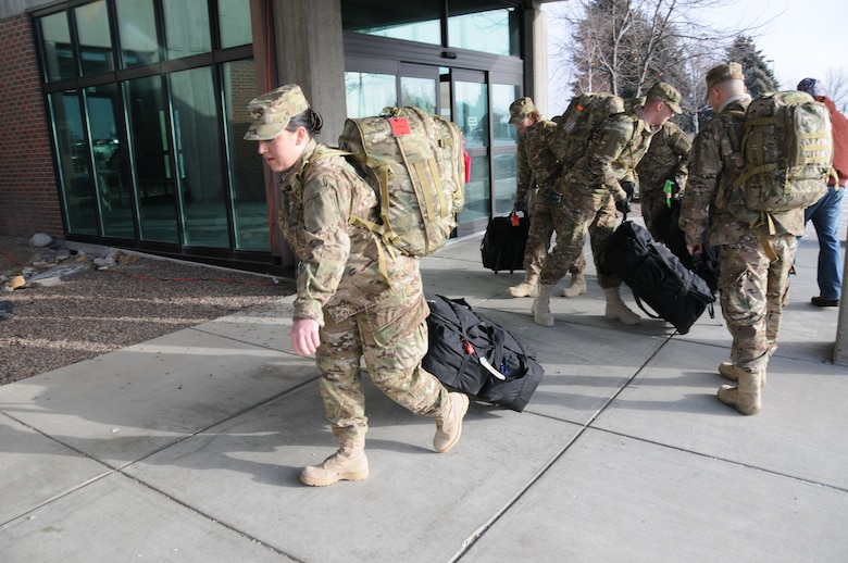 Deploying 120th Security Forces Squadron member Senior Airman Amanda Schmidt brings her bags into the Great Falls International Airport on Dec. 23, 2012.  National Guard photo by Senior Master Sgt. Eric Peterson.