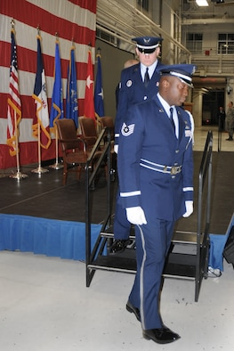 Tech. Sgt. Patrick Kazeze (front) performs in the 132nd Fighter Wing (132FW) Honor Guard.
