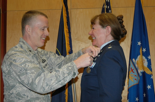 Brig. Gen. Kenneth Gammon presented the Meritorious Service Award to Lt. Col. Cecilia Nackowski during her retirement ceremony at the Utah Air National Guard Base Dec. 2. Nackowski formally retired after 35 years of military service. (U.S. Air Force photo by Capt. Wayne Lee)(RELEASED)