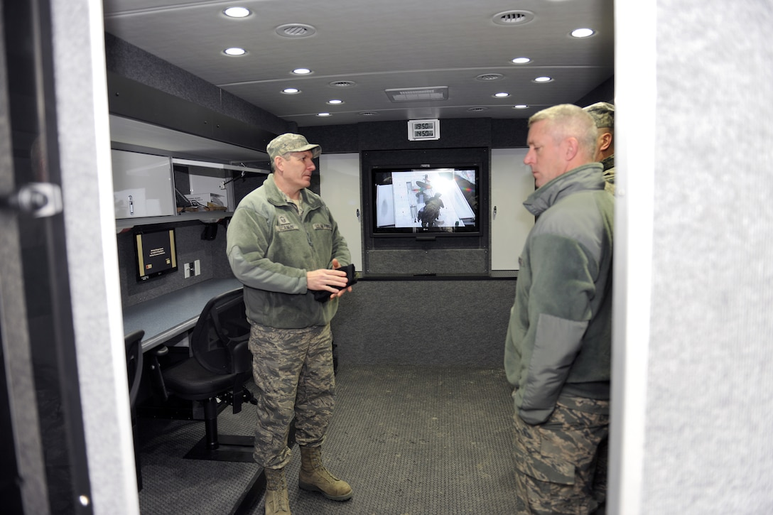 New York Air National Guard Senior Master Sgt. Kevin Scanlin gives a tour inside the New York State Mobile Emergency Operations Center (MEOC) assigned to the 174th Civil Engineering Squadron being trained on at Hancock Field in Syracuse NY on 5 Jan 2012.  The MEOC was assigned to the unit to assist in emergency response missions such as natural disasters in the northeast and FEMA 2 region.  (US Air National Guard Photo by Staff Sgt. Chris Ewsuk/Released)
