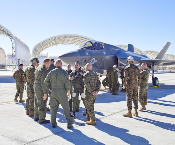 F-35B pilot instructor Maj. A. C. Liberman greets Yuma-based Marines upon his arrival  to Marine Corps Air Station Yuma after flying in Third Marine Aircraft Wing's first F-35B to the station flightline, Nov. 16. The arrival of the aircraft marks the beginning of a new chapter in Marine Corps aviation history, bringing the latest and greatest aircraft in the world to the tip of America's expeditionary spear.  The arrival of the F-35B to MCAS Yuma highlights next week's official re-designation of Marine All Weather Fighter Attack Squadron 121, an F/A-18 Hornet Squadron, as the world's first operational F-35 squadron at MCAS Yuma.  MCAS Yuma is scheduled to receive four operational squadrons consisting of up to 16 aircraft plus one Operational Testing and Evaluation (OT&E) squadron with up to 8 aircraft.