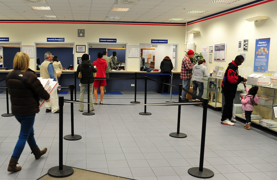 A line forms shortly before the Northside Post Office closes for the day on Ramstein Air Base, Germany, Dec. 18, 2012. The post office receives its highest customer traffic during the holiday season. (U.S. Air Force photo/Airman 1st Class Jordan Castelan)
