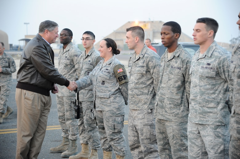 Secretary of the Air Force Michael Donley greets Airmen at the 386th Air Expeditionary Wing during a visit to a base in Southwest Asia on Dec. 30, 2012. Donley and Chief Master Sgt. of the Air Force James Roy visited the wing as part of a multi-base tour of the region to thank Airmen for their service and to discuss Air Force issues. (U.S. Air Force photo by Staff Sgt. Austin Knox)
