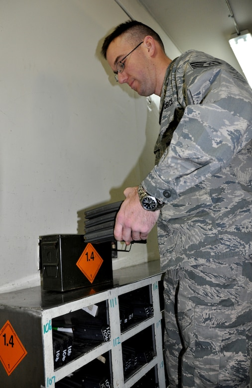 Staff Sgt. James Hastings, 51st Security Forces armory assistant NCO in charge, organizes rounds of ammunition into ammo cans Jan. 4, 2013. The 51st Security Forces Squadron Armory is the largest in the Pacific Air Force by size and amount of weapons, housing millions of dollars worth of ammo and weaponry to include M-9 pistols, M-4 carbine rifles, M-203 Grenade Launcher, M-240B Machine Gun, M-249 Machine Gun, MMK-19, and the M-24 sniper weapon system. (U.S. Air Force photo/Senior Airman Kristina Overton)