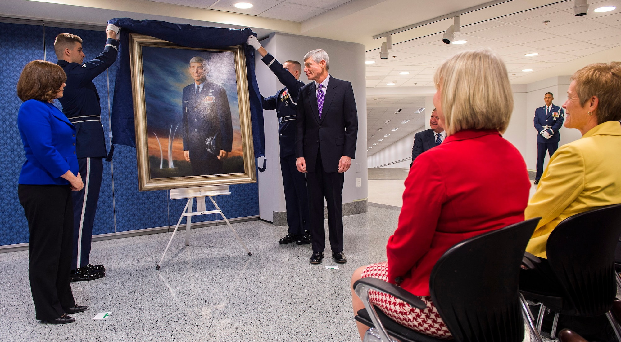 Retired Gen. Norton Schwartz and artist Michele Rushworth look on as the former chief of Staff of the Air Force's official portrait is unveiled in the Pentagon, Washington, D.C., on Jan. 8, 2013. The portrait will be on display in the Pentagon's Arnold Corridor alongside the portraits of the other former Air Force chiefs of staff. (U.S. Air Force photo/Jim Varhegyi)