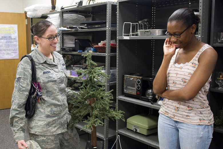 Senior Airman Alicia Rivera (left) and Senior Airman Alayna Reese (right), 45th Comptroller Squadron, visit Airman's Attic. Airman's Attic is open Monday through Friday from 9 a.m. to 3 p.m. (U.S. Air Force photo/ Matthew Jurgens)