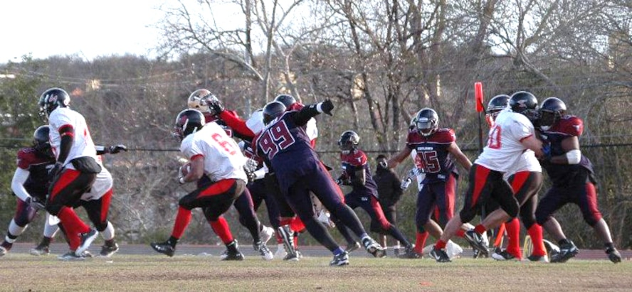 GOODFELLOW AIR FORCE BASE, Texas--Senior Airman Clifton Gathers, jersey number six, of the 17th Comptroller Squadron, demonstrates his skill on the field, during a game versus the Central Texas Outlaws, an Austin based semi-professional football team. (Courtesy photo)