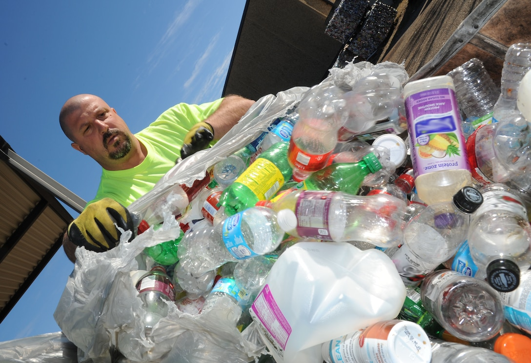 Duane Olsen, recycling center contractor, separates plastic and aluminum materials into different bins. Keesler's recycling center recently won the Environmental Hero Award, Recycler of the Year in the state and federal government category from the Mississippi Recycling Coalition. In fiscal year 2012, the center recycled 2,383 tons of materials including 323.45 tons of food waste, a unique effort in south Mississippi. This effort saved $99,555.44 from going to landfills and resulted in $180,119 of revenue being returned to the base. (U.S. Air Force photo by Kemberly Groue