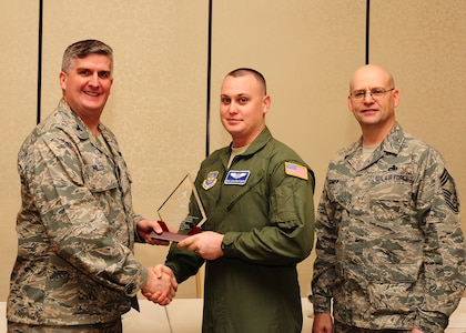 Col. Al Miller, 437th Airlift Wing vice commander, and Chief Master Sgt. Gerard Komen, 437th Maintenance Operations Squadron superintendent, present the Diamond Sharp award to Senior Airman Daniel Butler, 17th Airlift Squadron loadmaster Jan. 8, 2013, at Joint Base Charleston - Air Base, S.C. The Diamond Sharp awards recognize individuals in a unit who stand out to their first sergeant. (U.S. Air Force photo/ Airman 1st Class Chacarra Walker)