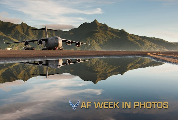 A C-17 Globemaster III sits on the runway at Pago Pago International Airport in American Samoa, Dec. 16, 2012. The 446th Airlift Wing aircrew from Joint Base Lewis-McChord, Wash., traveled to Royal Australian Air Force Base Richmond, Australia, in support of a joint operation. Tropical Cyclone Evan passed over American Samoa Dec. 12 -16 causing 6,000 people to take shelter in evacuation centers and $4.1 million in damages to infrastructure. The puddle in the foreground is a result of the rains from that storm system. (U.S. Air Force photo/Staff Sgt. Jon Polka)