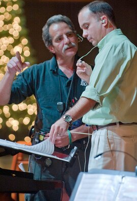"Air Force Academy Band leader Lt. Col. Don Schofield, right, speaks with producer Bill Turner at a rehearsal for the Emmy-nominated production, ""Holiday Notes from Home"" in October 2011. (Photo courtesy of Lt. Col. Don Schofield)"