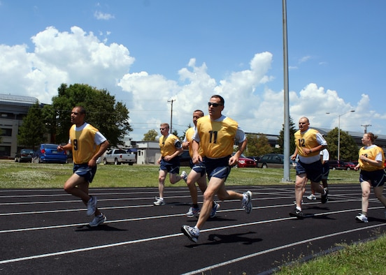 WRIGHT-PATTERSON AIR FORCE BASE, Ohio - Dr. (Lt. Col.) Jeffrey Beery, 445th Aerospace Medicine Squadron occupational health programs chief, says a double-time cadence of 180 steps per minute is very helpful for those training for their Air Force fitness run as it will greatly reduce the likelihood of shin splints and other musculoskeletal injury. (U.S. Air Force photo/Senior Airman Matthew Cook)