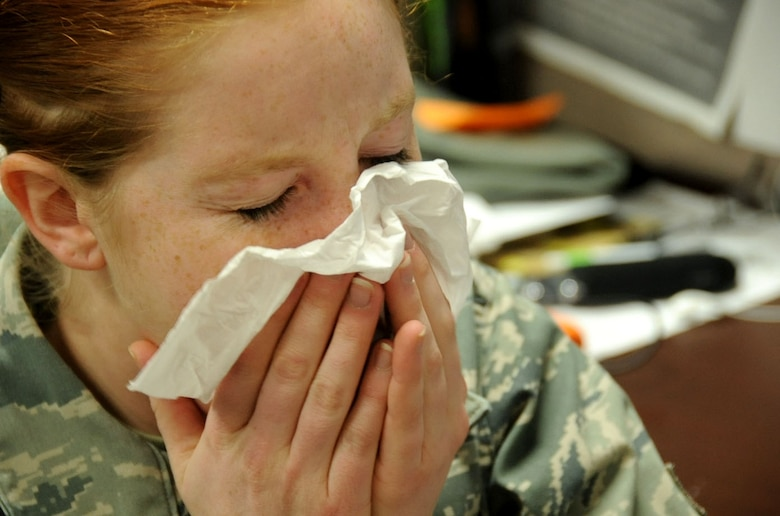 U.S. Air Force Airman 1st Class Kia Atkins, 35th Fighter Wing public affairs photojournalist, sneezes into a tissue while suffering from a cold at Misawa Air Base, Japan, Jan. 9, 2013. The average healthy, individual will suffer a cold at least three times a year or seasonally. According to the Centers for Disease Control and Prevention, the quantity of cold and flu-sufferers increase during October and last till February. For more information on health and wellness or to schedule an appointment, call the 35th Medical Group at 226-6111. (U.S. Air Force photo by Airman 1st Class Kenna Jackson)