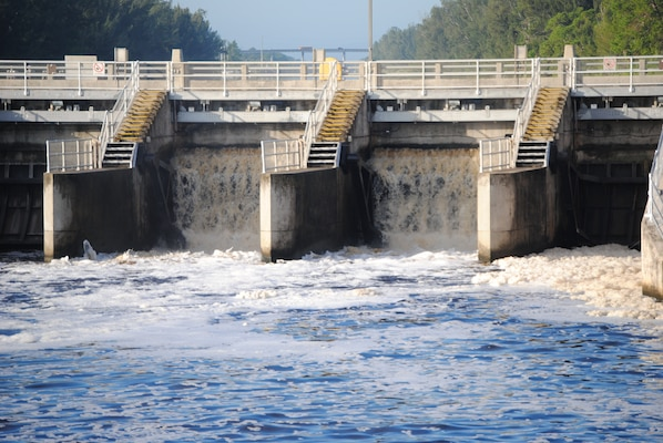 Water flows through the gates of the St. Lucie Lock in late September, as Jacksonville District started discharges from Lake Okeechobee to stem the rapid rise in lake levels after Tropical Storm Isaac.  The releases began Sept. 19 and continued until early November.