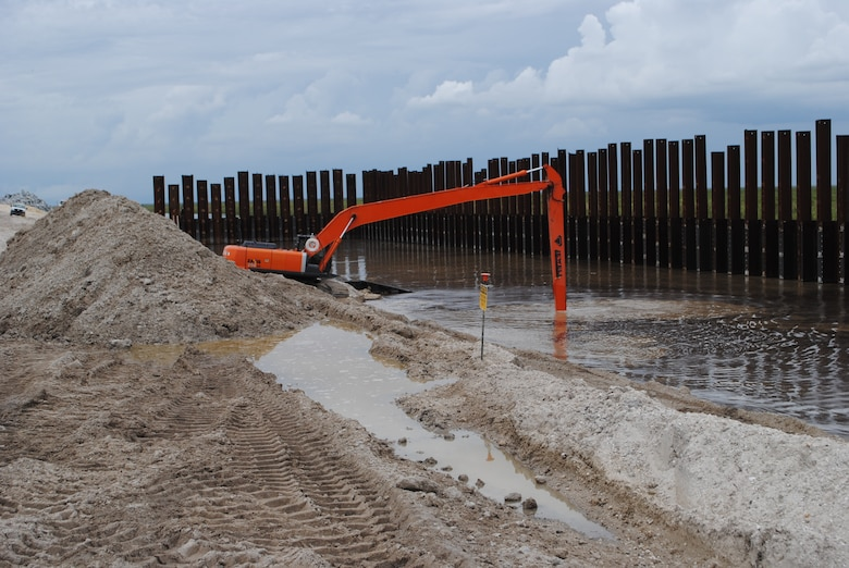 "A long-reach excavator ""demucks"" an area near Culvert 1A while replacing the water control structure between Moore Haven and Clewiston. Jacksonville District has two ongoing culvert replacement projects, and awarded a contract for a third project in September. In total, 32 water control structures are expected to be removed, replaced, or abandoned over the next six years."