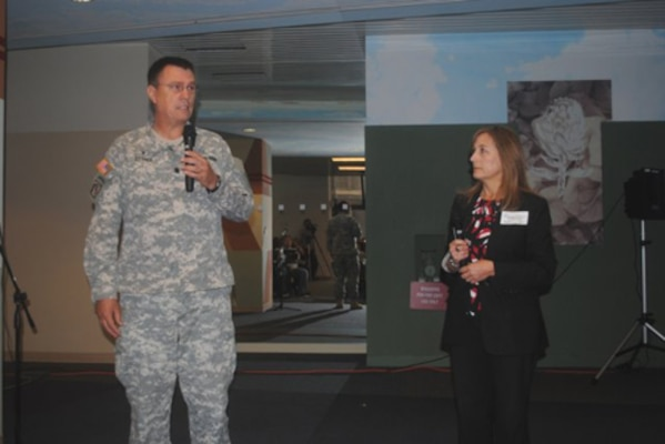 Lt. Col. Dann Ettner, deputy command chaplain of the 63rd Regional Support Command, and Jeanette Longtin, director of Psychological Health at the 63rd RSC, discuss suicide prevention Oct. 11 with employees from the Corps' South Pacific Division and San Francisco District.