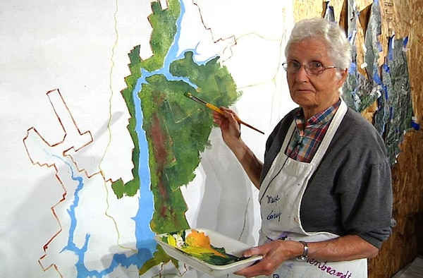 Local artist Marge Gray paints a mural of Lake Sonoma for the new Milt Brandt Visitor Center.