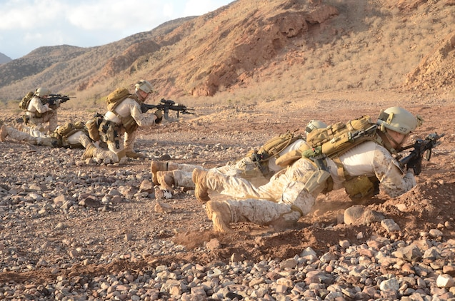 U.S. Marines with the 15th Marine Expeditionary Unit, perform rifle qualification drills at Arta Beach, Djibouti, Dec. 18, 2012. The 15th MEU is deployed as part of the Peleliu Amphibious Ready Group as a U.S. Central Command theater reserve force, providing support for maritime security operations and theater security cooperation efforts in the U.S. 5th Fleet area of responsibility. (U.S. Marine Corps photo by Cpl. Richard P. Sanglap-Heramis/Not Released)