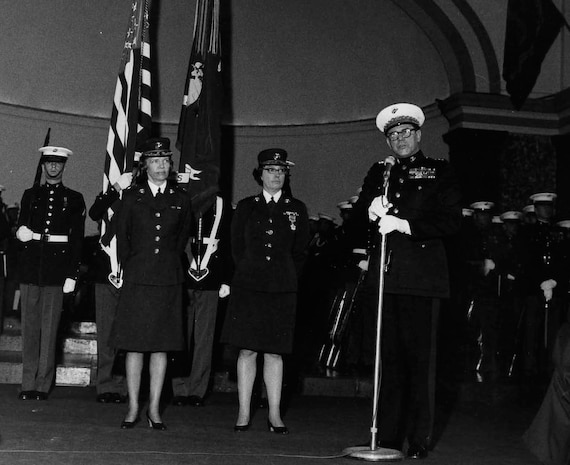 Col. Margaret A. Brewer, left, succeeds Col. Jeanette T. Sustad as director of Women Marines Jan. 31, 1973. Brewer was the seventh and final director. At the right is Gen. Robert E. Cushman Jr., 25th commandant of the Marine Corps.
