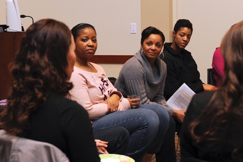 Chief Master Sgt. Marilyn Savage, 460th Mission Support Group chief enlisted advisor, third from left,  participates in a group discussion Jan. 10, 2013, at the Buckley Air Force Base Leadership Development Center during the Ladies Empowerment Social and Book Club. Attendees discussed topics about sexual assault and sexual assault prevention. (U.S. Air Force photo by Senior Airman Marcy Glass/Released)